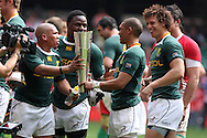 Ricky Januarie of South Africa (l) hands the Prince William cup to try scorer Juan De Jongh (2nd right). Wales v South Africa,    at Millennium Stadium in Cardiff on Sat 5th June 2010. pic by Andrew Orchard,  Andrew Orchard sports photography,
