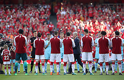 Arsenal manager Arsene Wenger walks through a guard of honour before the Premier League match at the Emirates Stadium, London.
