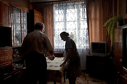 Mykola Shevchuk, 74, and Olga Shevchuk, 70, are seen at home after a Òspecial consultationÓ held by attorneys and paralegals for potential clients who are children of the Second World War, Rivne, Ukraine, June 16, 2011. This vulnerable group is made up of seniors, most of whom are not receiving proper compensation as promised by the government. The legal team advises them on how to properly fill out forms and submit them to the courthouse, while encouraging them not to give up on their rights. More than half of the worldÕs population, four billion people, live outside the rule of law, with no effective title to property, access to courts or redress for official abuse. The Open Society Justice Initiative is involved in building capacity and developing pilot programs through the use of community-based advocates and paralegals in Sierra Leone, Ukraine and Indonesia. The pilot programs, which combine education with grassroots tools to provide concrete solutions to instances of injustice, help give poor people some measure of control over their lives.