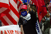 "A Japanese man, wearing  a Make America Great Again baseball cap is one of several hundred people, taking part in a ""March For Trump"" rally  in support of the out-going United States President, Donald Trump. Tokyo, Japan. Wednesday January 6th 2021. The rally of mostly Japanese people took place as part of a similar rally by Trump-supporters in Washington DC as the results of the 2020 US Presidential election were confirmed."