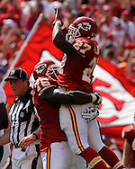 Running back Larry Johnson #27 of the Kansas City Chiefs celebrates after scoring a touchdown in the second quarter with teammate Brandown Albert #76 against the Denver Broncos at Arrowhead Stadium in Kansas City, Missouri on September 28, 2008.....
