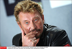File photo : © Francis Petit/ABACA. 37966-5. Toronto-ON-Canada, 12/09/2002. Actor Johnny Hallyday at a pressconference for the movie L'Homme du Train during the Toronto International Film Festival.