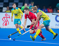 BHUBANESWAR, INDIA -  Liam Ansell(Eng) with Daniel Beale (Aus)  , England v Australia for the bronze medal during the Odisha World Cup Hockey for men  in the Kalinga Stadion.   COPYRIGHT KOEN SUYK