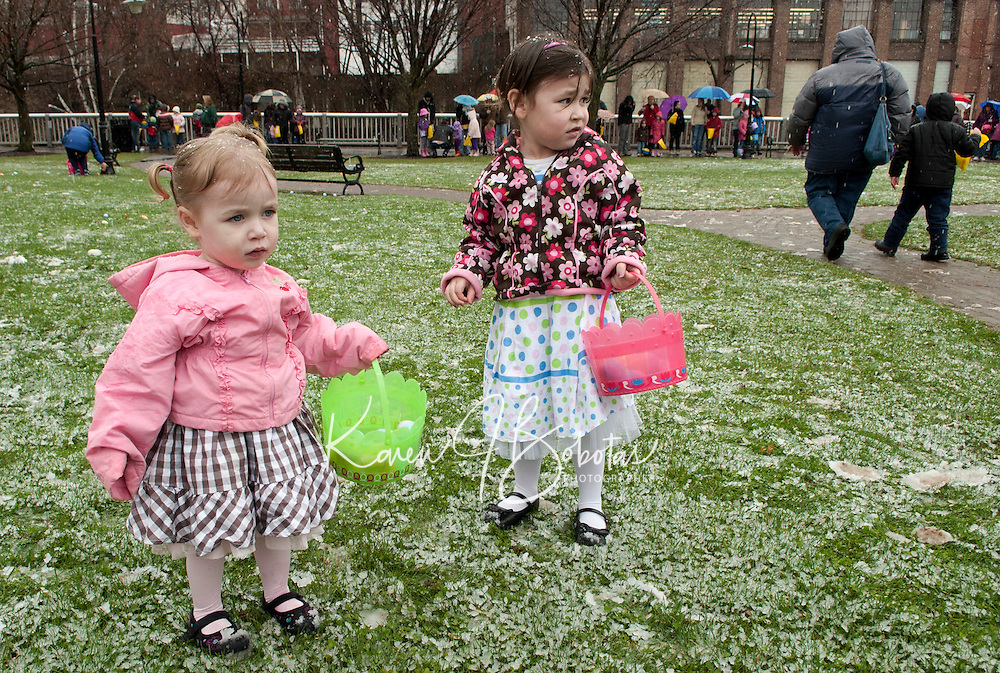 The snow did not stop Brooklyn and Brianna Dame from getting all dressed up in their Easter finery for the Eggstravaganza Easter Hunt at Rotary Park Saturday afternoon.  (Karen Bobotas/for the Laconia Daily Sun)Downtown Laconia's Easter Eggstravaganza event Saturday April 23, 2011.