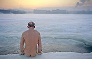 """St Petersburg, Russia, 01/01/2003..A wiinter ice swimmer, or """"walrus"""" greets the new year with his daily swim in the River Neva as temperatures plunged to -35C duirng an unusually cold holiday period.."""
