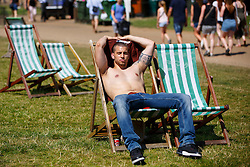 © Licensed to London News Pictures. 19/07/2016. London, UK. People sunbathe as they enjoy the hottest day of the year so far in the UK in Green Park in London on Tuesday, 19 July 2016. Photo credit: Tolga Akmen/LNP