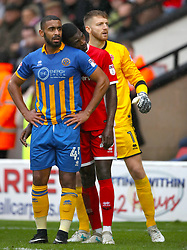Walsall's Amadou Bakayoko pretends to fall asleep on shoulder Shrewsbury Town's Stefan Payne as they wait for a corner to be taken