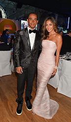LEWIS HAMILTON and NICOLE SCHERZINGER at the GQ Men Of The Year 2014 Awards in association with Hugo Boss held at The Royal Opera House, London on 2nd September 2014.