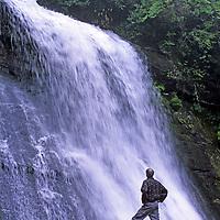 NORTH CAROLINA. Hiker and waterfall, Great Smoky Mountains National Park.
