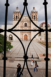 North America, Mexico, Oaxaca Province, Oaxaca, Cathedral known as  Iglesia y Ex-convento de Santo Domingo, viewed through wrought-iron window grill