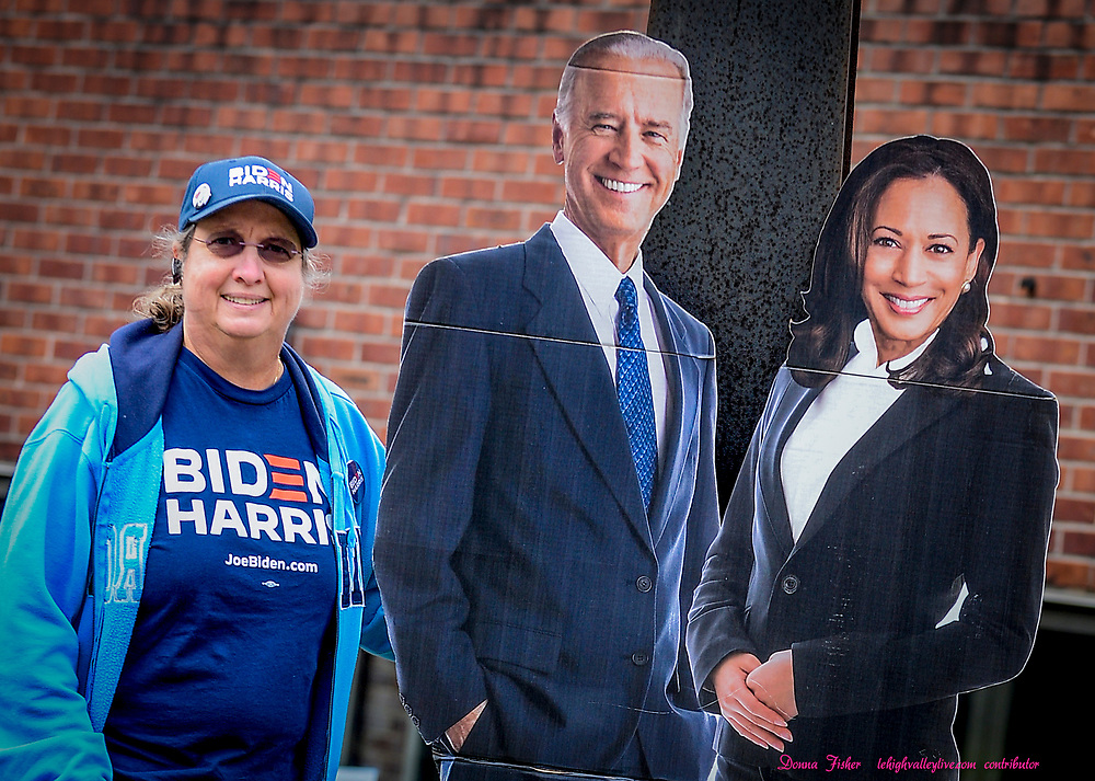 Mary Suydam of East Allen Township joins a cardboard cutout of the Democratic ticket at Van Bittner Hall.<br /> A Riding 4 Biden caravan of cars is held Sunday, Oct. 25, 2020 in Bethlehem in support of the Biden-Harris ticket. It is organized by Jerry Green, president of the U.S. Steelworkers of America Local 2599 and starts at the union's Van Bittner Hall.