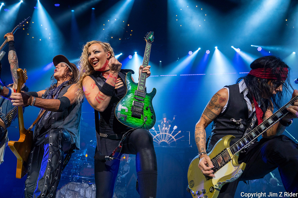 Guitarist RYAN ROXIE, left, NITA STRAUSS, vocals and guitar, and TOMMY HENRIKSEN, rhythm and lead guitar, perform with Alice Cooper.  After nearly 19 months off stage, Rock and Roll legend ALICE COOPER, 73, launches his fall 2021 tour at Ocean Casino Resort in Atlantic City, New Jersey.