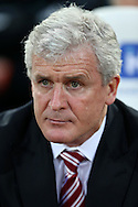 Stoke city manager Mark Hughes  sits in the dugout before k/o. Barclays Premier league match, West Ham Utd v Stoke city at the Boleyn Ground, Upton Park  in London on Saturday 12th December 2015.<br /> pic by John Patrick Fletcher, Andrew Orchard sports photography.
