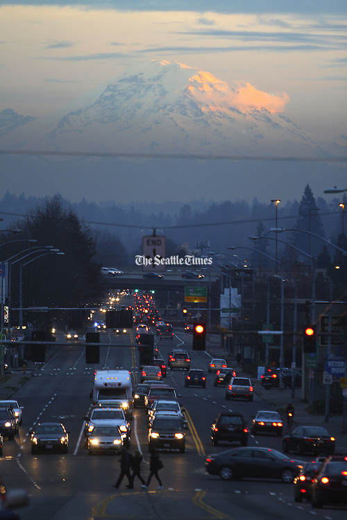A view down Rainier Avenue South with Mt. Rainier bathed in sunset light in Seattle. (John Lok / The Seattle Times)