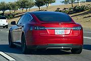 A red Tesla Model S drives on Interstate 10, Friday, Oct. 2, 2020, in Phoenix, Ariz. (Dylan Stewart/Image of Sport)