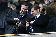 Steve Kavanagh, the Chief Executive of Millwall shows his phone to Constantine Gonticas, the club director of Millwall in the stand. The Emirates FA Cup 3rd round match, Millwall v AFC Bournemouth at The Den in London on Saturday 7th January 2017.<br /> pic by John Patrick Fletcher, Andrew Orchard sports photography.