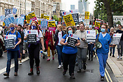 NHS staff march from St Thomas Hospital to Downing Street to protest against the NHS Pay Review Bodys recommendation of a 3% pay rise for NHS staff in England on 30th July 2021 in London, United Kingdom. The protest march was supported by Unite the union, which has called on incoming NHS England Chief Executive Amanda Pritchard to ensure that a NHS pay rise comes from new Treasury funds rather than existing NHS budgets and which is shortly expected to put a consultative ballot for industrial action to its members.