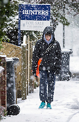 © Licensed to London News Pictures. 29/04/2016. Leeds UK. Picture shows a paper boy in the snow this morning. Leeds woke to a covering of snow this morning & is expected to get further snow showers over the weekend. Photo credit: Andrew McCaren/LNP