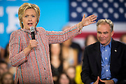 Senator Tim Kaine (D-VA) looks on as Hillary Clinton, presumptive 2016 Democratic presidential nominee, campaigns at Northern Virginia Community College in Annandale, Va., U.S., on Thursday, July 14, 2016. Clinton and the former Virginia Governor discussed their shared commitment to building an America that is stronger together, while emphasizing that Donald Trump's divisive agenda would be dangerous for America. Kaine is considered to be the frontrunner for the Vice Presidential slot. Photographer: Pete Marovich/Bloomberg