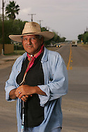 Jay Johnson Castro poses for a portrait at the end of his 15th day of walking, which ended just outside of Brownsville