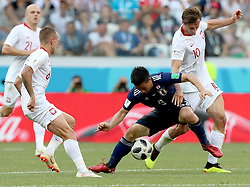 VOLGOGRAD, June 28, 2018  Grzegorz Krychowiak (1st R) of Poland vies with Shinji Okazaki (2nd R) of Japan during the 2018 FIFA World Cup Group H match between Japan and Poland in Volgograd, Russia, June 28, 2018. (Credit Image: © Yang Lei/Xinhua via ZUMA Wire)