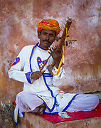 """""""Ravanhatha"""" a bow string instrument is made by bamboo & coconut shell mainly by player himself. It consists nearly 17 strings in which two main strings are called """"Roda"""" and """"Chadhav"""" tied with 15 """"Moranis"""" and 2 """"Moranas"""". """"Chadhav"""" string is made by horse tail hairs. The bow is made by local wood called """"Gengan"""" with horse tail hairs. This instrument is attached with folk hero """"Pabuji"""" epic performance and performer is called as BHOPA of Pabuji. They belongs to Nayak, Bhil or Thori caste group in Rajasthan. <br /> .....<br /> Rajasthan is one of the states of India and home to several important centers of Indian musical development, including Udaipur, Jodhpur and Jaipur. The region's music shares similarities both with nearby areas of India and the other side of the border, in the Pakistani province of Sindh. Rajasthan has a diverse collection of musician castes, including langas, sapera, bhopa, jogi and Manganiar. There are two traditional classes of musicians: the Langas, who stuck mostly exclusively to Muslim audiences and styles, and the Manganiars, who had a more liberal approach. Traditional music includes the women's Panihari songs, which lyrically describes chores, especially centered around water and wells, both of which are an integral part of Rajasthan's desert culture. Other songs, played by various castes, normally begin with the alap, which sets the tune and is followed by a recital of a couplet (dooba). Epic ballads tell of heroes like Devnarayan Bhagwan, Gogaji, Ramdeoji, Pabuji and Tejaji. The celebration of changing seasons is also very central to folk music of Rajasthan. Celebration of the coming of the Monsoons or the harvest season are central to most traditional folk songs. Songs also revolve around daily activities of the local people for instance a song about not sowing Jeera (Cummin) as it is difficult to tend. Or for instance another song about Podina (Mint) and how it is liked by various members of the family (an allegorical reference t"""