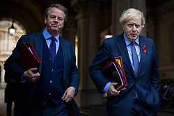 © Licensed to London News Pictures. 01/12/2020. London, UK. Secretary of State for Scotland Alister Jack (L) and Prime Minister Boris Johnson (R) return to Downing Street after the cabinet meeting. MPs will later vote on a new set of tiered restrictions to replace the national lockdown after 2 December. Photo credit: Rob Pinney/LNP
