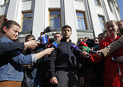 May 4, 2019 - Kiev, Ukraine - TV comedian turned politician VOLODYMYR ZELENSKY (C) speaks to the media after his meeting with lawmakers of Ukrainian Parliament during which he decided on May 19 as his inauguration date. (Credit Image: © Pavlo Gonchar/SOPA Images via ZUMA Wire)