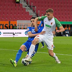 17.06.2020, Fussball 1. Bundesliga 2019/2020, 32. Spieltag, FC Augsburg - TSG 1899 Hoffenheim, in der WWK-Arena Augsburg. (L-R) Benjamin Hübner (TSG 1899 Hoffenheim) gegen Alfred Finnbogason (FC Augsburg)<br /> <br /> Foto: Bernd Feil/MIS/Pool/PIX-Sportfotos<br /> <br /> Nur für journalistische Zwecke! Only for editorial use! <br /> <br /> Gemäß den Vorgaben der DFL Deutsche Fußball Liga ist es untersagt, in dem Stadion und/oder vom Spiel angefertigte Fotoaufnahmen in Form von Sequenzbildern und/oder videoähnlichen Fotostrecken zu verwerten bzw. verwerten zu lassen. DFL regulations prohibit any use of photographs as image sequences and/or quasi-video.    <br /> <br /> National and international NewsAgencies OUT.