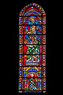 Medieval Window of the South Transept of the Gothic Cathedral of Chartres, France- Circa 1225-30. A UNESCO World Heritage Site. This window was a donation of the Mauclerc family, the Counts of Dreux-Bretagne, who are depicted with their arms in the bases of the lancets above it shows one of the four evangelists sitting on the shoulders of four Prophets - a rare literal illustration of the theological principle that the New Testament builds upon the Old Testament. .<br /> <br /> Visit our MEDIEVAL ART PHOTO COLLECTIONS for more   photos  to download or buy as prints https://funkystock.photoshelter.com/gallery-collection/Medieval-Middle-Ages-Art-Artefacts-Antiquities-Pictures-Images-of/C0000YpKXiAHnG2k