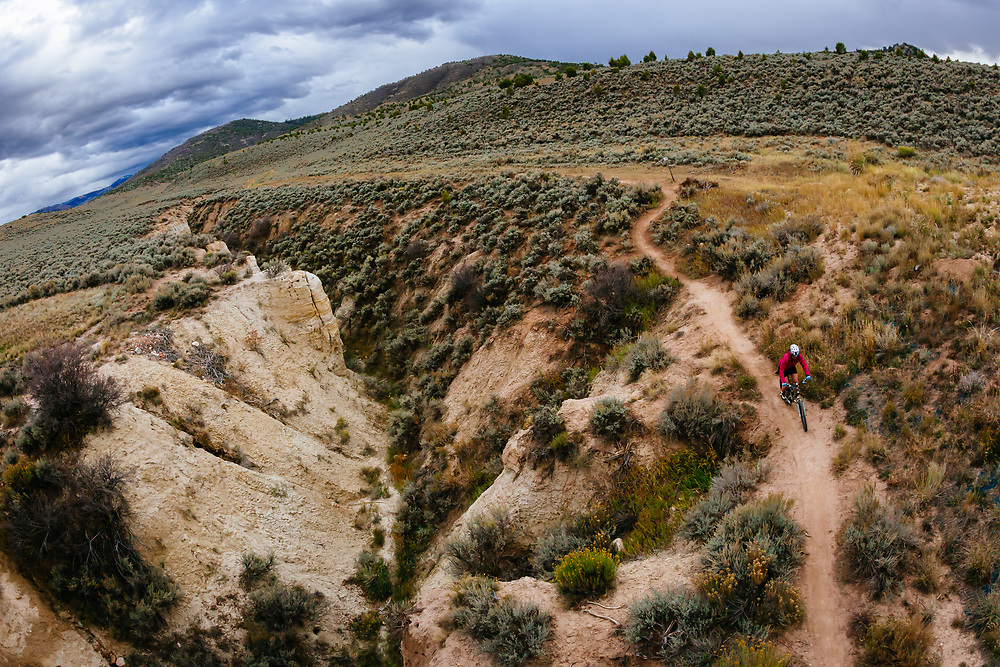 Maggie Fitzgerald descends into the canyon along the Race Course Trail in Eagle Ranch, Colorado.