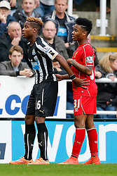 Rolando Aarons of Newcastle United and Raheem Sterling of Liverpool in action - Photo mandatory by-line: Rogan Thomson/JMP - 07966 386802 -01/11/2014 - SPORT - FOOTBALL - Newcastle, England - St James' Park - Newcastle United v Liverpool - Barclays Premier League.