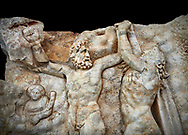 Close up of a Roman Sebasteion relief sculpture of Zeus and Prometheus, Aphrodisias Museum, Aphrodisias, Turkey.   Against a black background. <br /> <br /> Prometheus is screaming in pain. Zeus had given him a terrible punishment for giving fire to man: he was tied to the Caucasus mountains and had his liver picked out daily by an eagle. Herakles shot the eagle and is undoing the first manacle. He wears his trade mark lion-skin and thrown his club to one side. A small mountain nymph, holding a throwing stick appears amongst the rocks. .<br /> <br /> If you prefer to buy from our ALAMY STOCK LIBRARY page at https://www.alamy.com/portfolio/paul-williams-funkystock/greco-roman-sculptures.html . Type -    Aphrodisias     - into LOWER SEARCH WITHIN GALLERY box - Refine search by adding a subject, place, background colour, museum etc.<br /> <br /> Visit our ROMAN WORLD PHOTO COLLECTIONS for more photos to download or buy as wall art prints https://funkystock.photoshelter.com/gallery-collection/The-Romans-Art-Artefacts-Antiquities-Historic-Sites-Pictures-Images/C0000r2uLJJo9_s0