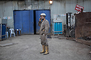 A miner at the Soma coal mine talks at the site of the ongoing rescue attmept. An explosion caused by an electrical fault in Somas' coal mine resulted in at least 282 deaths. Rescue efforts continue into the third evening. Soma, western Turkey