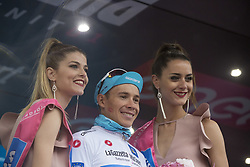 May 23, 2018 - Iseo, Italy - LOPEZ MORENO Miguel Angel.ASTANA PRO TEAM White jersey celebrates on the podium during the 101st Tour of Italy 2018, Stage 17 RIVA DEL GARDA-ISEO (FRANCIACORTA STAGE),  155 km  on May 23, 2018 in Iseo, Italy  (Credit Image: © Fabio Averna/NurPhoto via ZUMA Press)
