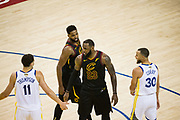 Golden State Warriors guard Klay Thompson (11) talks with Cleveland Cavaliers forward LeBron James (23) during Game 1 of the NBA Finals at Oracle Arena in Oakland, Calif., on May 31, 2018. (Stan Olszewski/Special to S.F. Examiner)