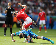 Gareth Bale of Wales  is challenged by Juraj Kucka of Slovakia. Euro 2016, Wales v Slovakia at Matmut Atlantique , Nouveau Stade de Bordeaux  in Bordeaux, France on Saturday 11th June 2016, pic by  Andrew Orchard, Andrew Orchard sports photography.