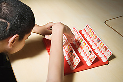 Pupil playing a game in a special school for physical disabilities