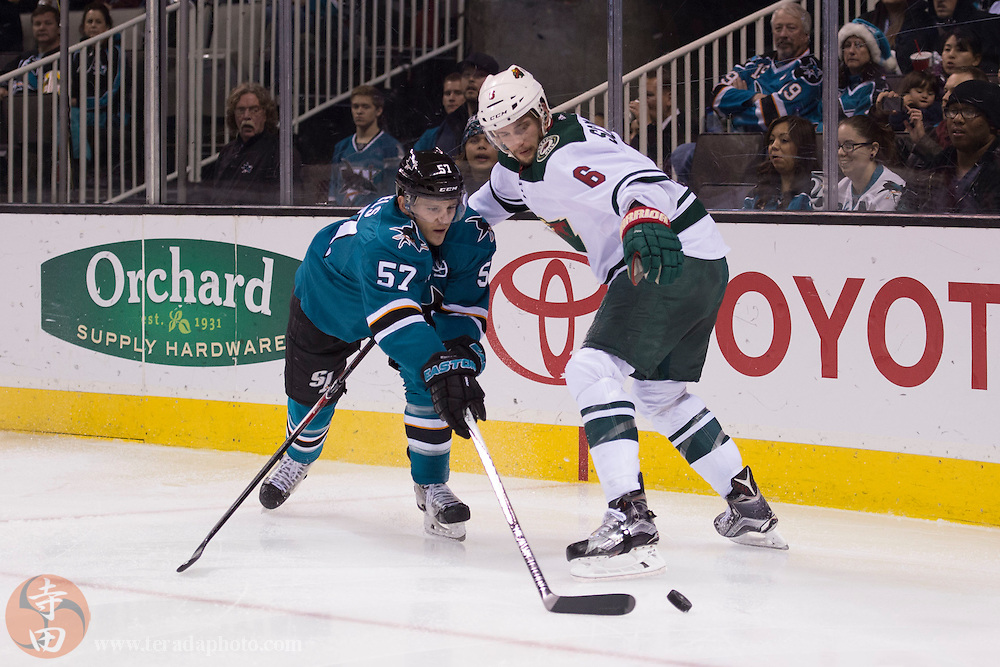 December 12, 2015; San Jose, CA, USA; San Jose Sharks center Tommy Wingels (57) and Minnesota Wild defenseman Marco Scandella (6) fight for the puck during the second period at SAP Center at San Jose.