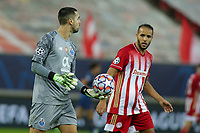 PIRAEUS, GREECE - DECEMBER 09: Diogo Costa of FC Porto and Youssef El-Arabi of Olympiacos FC during the UEFA Champions League Group C stage match between Olympiacos FC and FC Porto at Karaiskakis Stadium on December 9, 2020 in Piraeus, Greece. (Photo by MB Media)