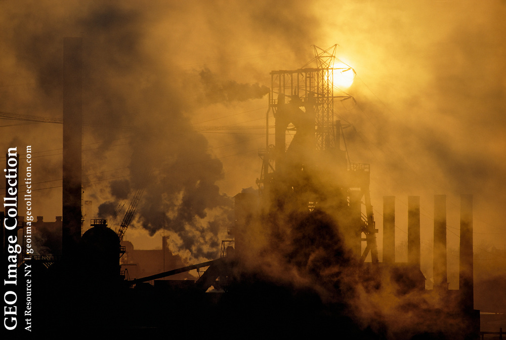 Smoke and steam in cold weather at a steel plant.