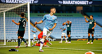 Football - 2019 / 2020 Premier League - Manchester City vs. Burnley<br /> <br /> Phil Foden of Manchester City celebrates at the Etihad Stadium. <br /> <br /> <br /> COLORSPORT/LYNNE CAMERON