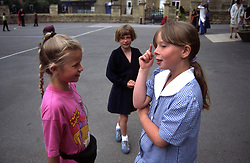 Hearing impaired and able bodied children in school playground; Yorkshire UK