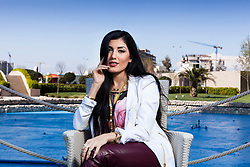 © Licensed to London News Pictures. 21/03/2014. ERBIL,  Kurdish singer Helen Abdulla - better known as Helly Luv - has suffered death threats from Islamic groups in Iraqi Kurdistan for her provocative, revolution-tinged music videos. Picture shows: Kurdish pop singer Helly Luv (Hillan Abdullah) during rehearsals before her performance in the Iraqi Kurdish city of Erbil. Photo credit : Jacob Russell/LNP