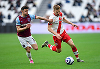 Football - 2020 / 2021 Premier League - Final Round - West ham United vs Southampton - London Stadium<br /> <br /> Southampton's Stuart Armstrong holds off the challenge from West Ham United's Aaron Cresswell.<br /> <br /> COLORSPORT/ASHLEY WESTERN