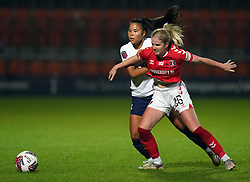 Tottenham Hotspur's Asmita Ale and Charlton Athletic's Lois Heuchan during the FA Women's League Cup Group C match at The Hive Stadium, London. Picture date: Wednesday October 13, 2021.