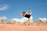 Native American Navajo Woman Yogini. Diné woman practicing yoga in her indigenous red earth environment.