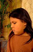 Native American boy age 12 visiting his grandmothers home.  St Paul  Minnesota USA