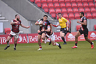 Ken Sio (2) of Salford Red Devils in action during the game