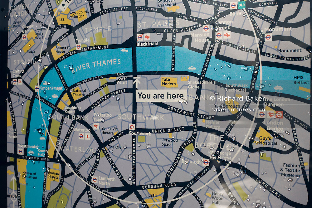 A You Are Here guide sign showing landmarks, the streets, roads and the River Thames in London, England.